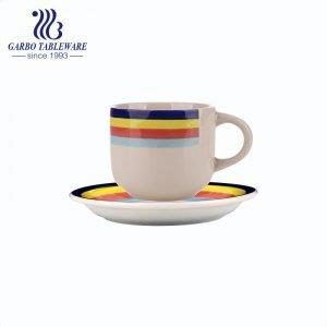 Juego de taza y plato de café pintado a mano de gres colorido barato