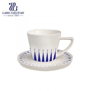 Triangle handle tea cup and saucer set with design