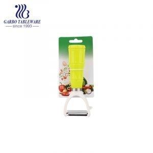 Pelador de frutas y verduras rallador de mango redondo de plástico para suministros de cocina para el hogar