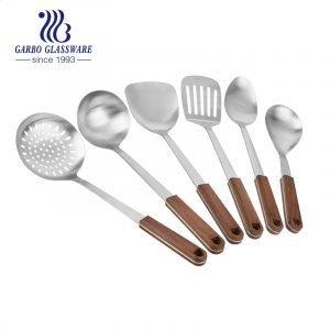 تعزيز سعر أواني المطبخ الفولاذ المقاوم للصدأ المقاوم للحرارة مجموعة مع حامل الخيزران