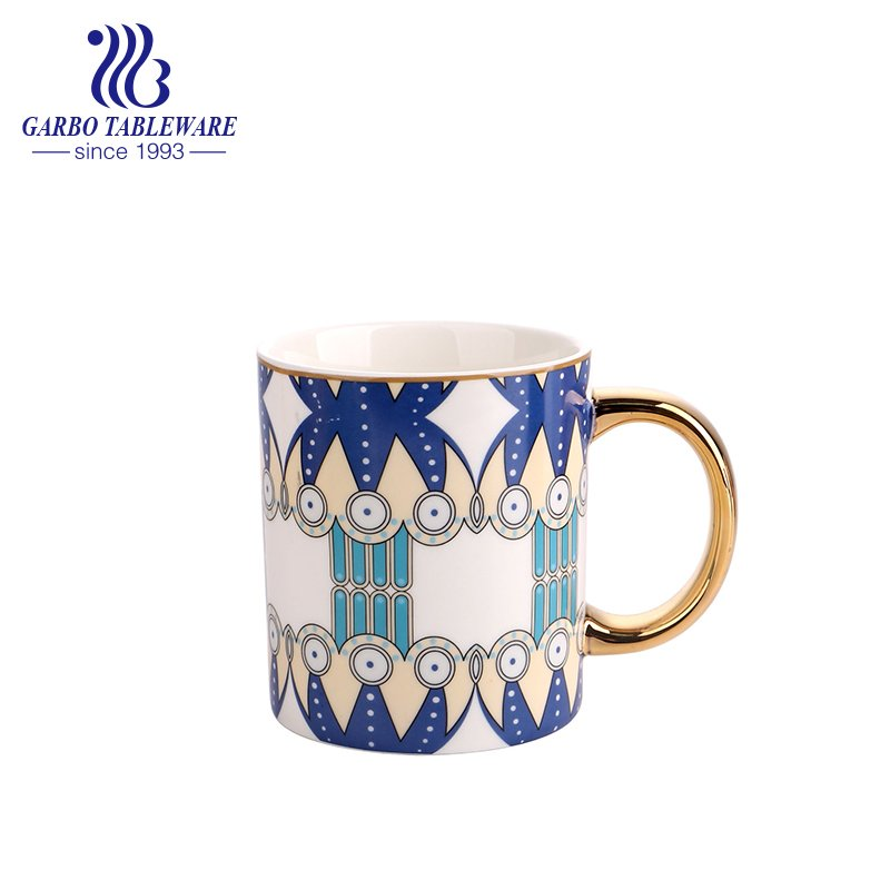 porcelain cup with gold handle