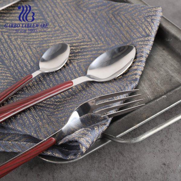 stainlees steel fork with plastic handle